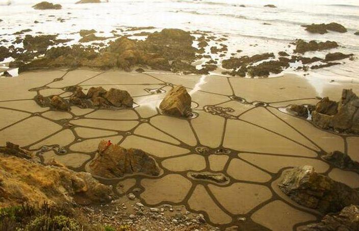 Рисунки на песке от Andres Amador